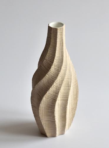 Soliflore en bois sculpté